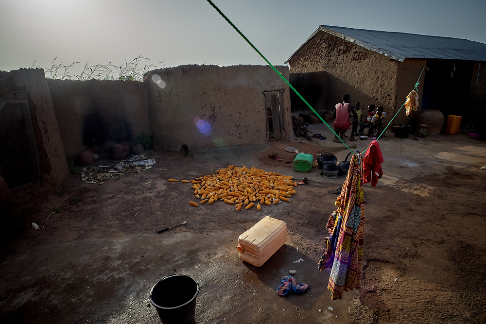 25/10/2019 / Ghana: <br /> <br /> Yellow corn dries on the compound of Ruth Abugri's house.<br /> <br /> Oxfam GB has raised enough money to build two new water pumps in Yabrago and Kugashego both very deprived communities in the Garu Tempane District of the Upper East Region.  A solar powered pump will make it possible for some of the community members to farm vegetables during the dry season, whilst providing community members with clean water all year round.