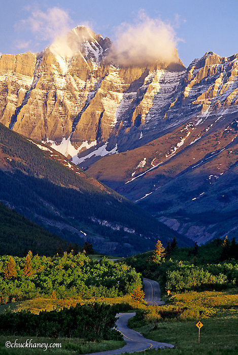 Red Rock Parkway winds towards Blakiston Mountain in the Waterton Lakes National Park of Alberta Canada