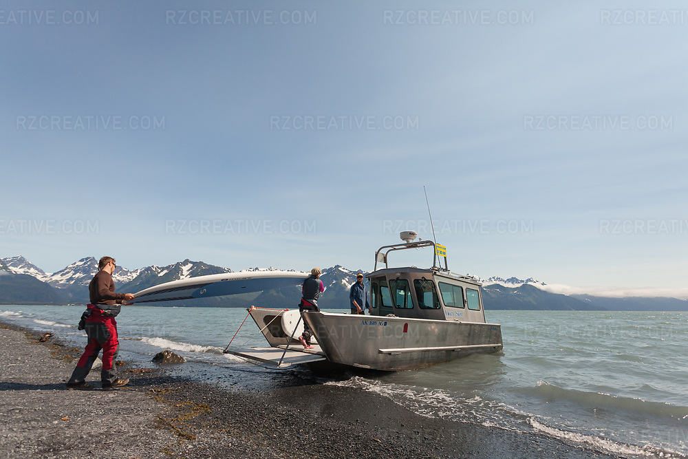 Transporting paddleboards from a beach in Seward to Bear Glacier via water taxi with Captain Louis Harding. Photo © Robert Zaleski / rzcreative.com<br /> —<br /> To license this image contact: robert@rzcreative.com