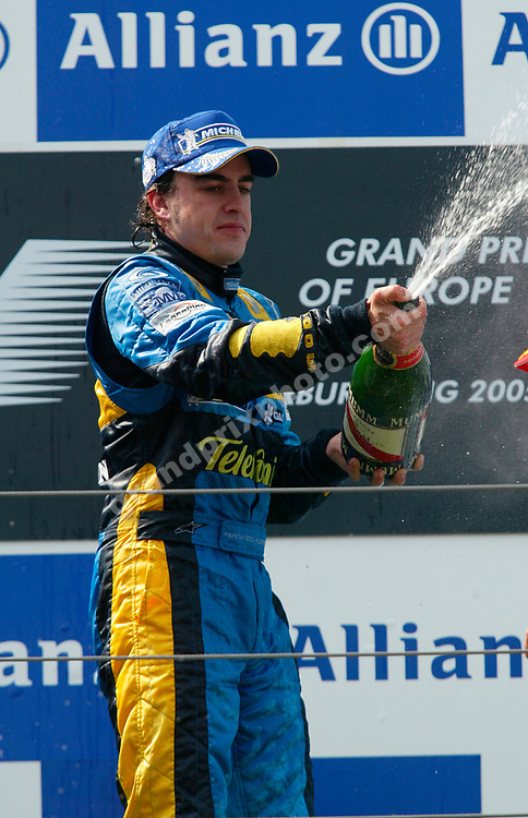 Fernando Alonso (Renault) celebrates with champagne after the 2005 European Grand Prix at the Nurburgring. Photo: Grand Prix Photo