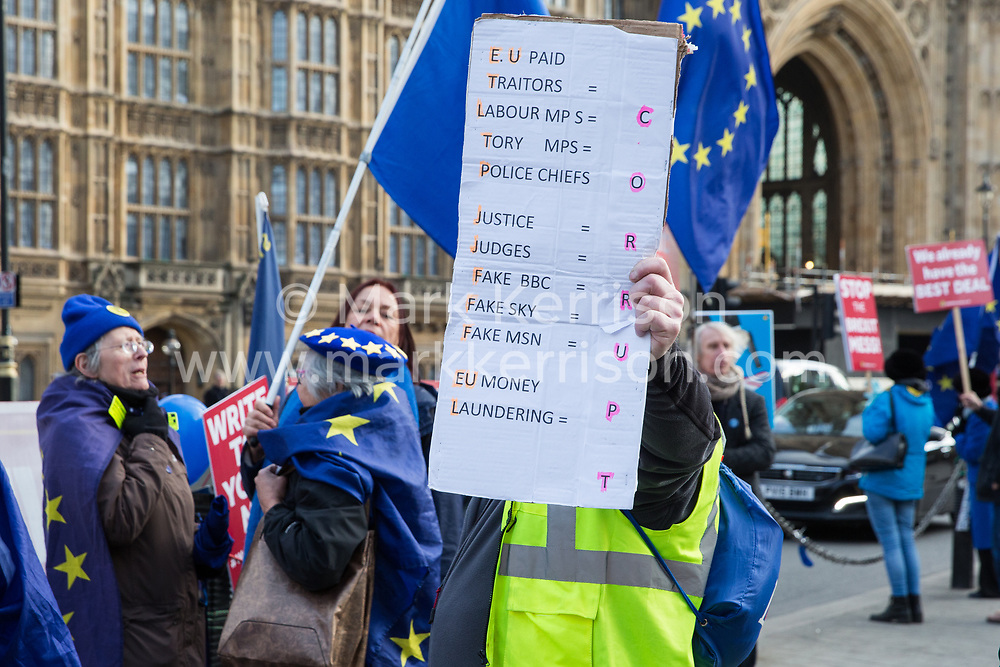 London, UK. 9th January, 2019. An activist from pro-Brexit group Yellow Vests UK antagonises pro-EU activists from SODEM (Stand of Defiance European Movement) during rival protests outside Parliament on the first day of the debate in the House of Commons on Prime Minister Theresa May's proposed Brexit withdrawal agreement.