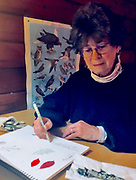 Artist at work at get away cabin, Judy Ballinger (released)