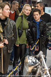 Spectators check out the great custom bikes at the Custom and Tuning Show, the custom bike show portion of the big Motor Spring bike show in Moscow, Russia. Saturday April 22, 2017. Photography ©2017 Michael Lichter.