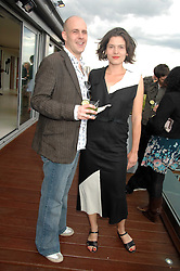PHIL VAUGHAN and VIOLA SEKULARAC at a party to celebrate the publication of 'All That Glitters' by Pearl Lowe held at the May Fair Hotel, London on 8th July 2007.<br />