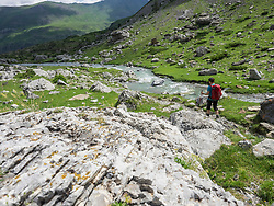 Woman hiking in the High Pyrenees near Pont d'Estaube, France