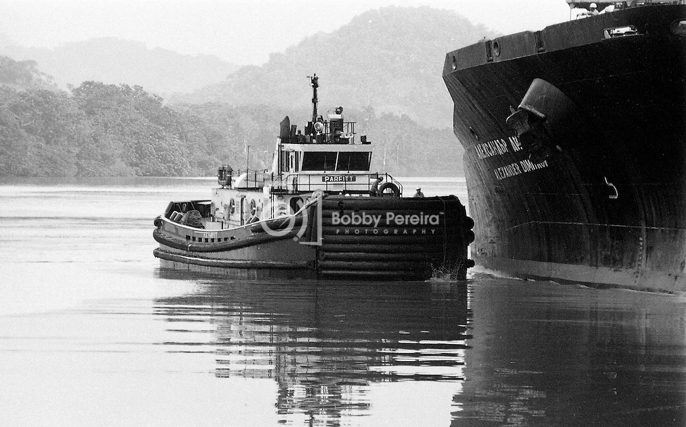 Tugboat pushing a ship at the Panama Canal.
