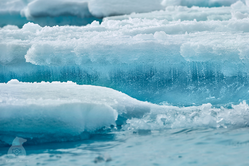 Sea water drips off an ice floe off the coast of Spitsbergen, Svalbard
