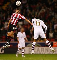 Photo: Steve Bond.<br />Sheffield United v Arsenal. Carling Cup. 31/10/2007. Billy Sharp (L) wins a header against Gilberto (R)