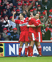 Fotball<br /> England 2004/2005<br /> Foto: SBI/Digitalsport<br /> NORWAY ONLY<br /> <br /> Middlesbrough v Blackburn Rovers<br /> Barclays Premiership, Riverside Stadium, Middlesbrough 05/02/2005<br /> <br /> Middlesbrough's Frank Queudrue (C) celebrates his goal with team-mates Stewart Downing (L) and Bolo Zenden (R).