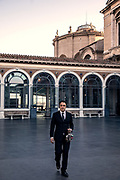 ROME, Vatican Museums, Gianni C, Giovanni Crea walking holding the Museum keys in the Pinacoteca Yard
