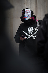 © Licensed to London News Pictures . 10/02/2014 . Manchester , UK . A woman dressed in a V for Vendetta mask at the demonstration . Protest outside Sunlight House in central Manchester - the offices of the CPS ( Crown Prosecution Service ) - this afternoon (10th February 2014) by a group campaigning following the police shooting of Anthony Grainger in Culcheth in Cheshire on 3rd March 2012 . This as GMP chief Sir Peter Fahy faces Health and Safety charges in relation to the shooting . Photo credit : Joel Goodman/LNP
