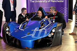 The Duke of Cambridge chats with Neil Briggs and Ian Briggs (right) co founders of BAC Briggs Automotive Company, as he sits in a BAC car worth £180,000 at the National Graphene Research Institute during a day of engagements in Manchester.