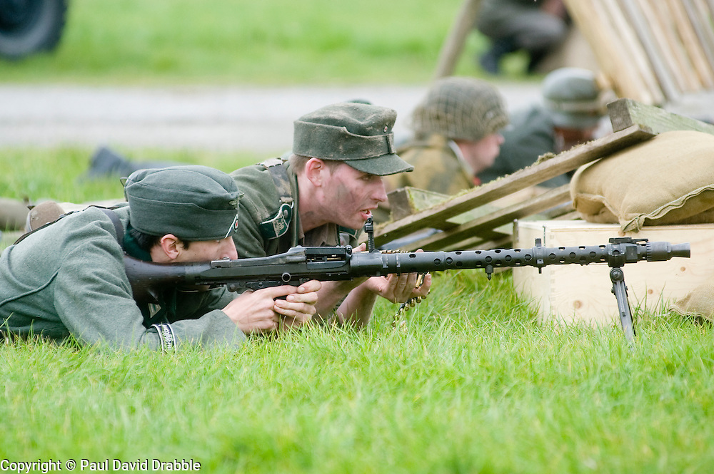 Reenactors portray members of the Gross Deutschland Division using an MG34 heavy machinegun during a large scale battle reenactment at the Pickering 1940s war weekend 16th-18th October 2009 Image Copyright Paul David Drabble