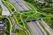 Nederland, Noord-Brabant, Breda, 09-05-2013; infrabundel, combinatie van autosnelweg A16 gebundeld met de spoorlijn van de HSL (re). Stadsduct Overbos in de voorgrond<br /> De bundel loopt in tunnelbakken, lokale wegen gaan over deze infrabundel heen, door middel van de zogenaamde stadsducten, gedeeltelijk ingericht als stadspark. <br /> Combination of motorway A16 and the HST railroad, crossed by  local roads by means of *urban ducts*, partly designed as public parks . <br /> luchtfoto (toeslag op standard tarieven);<br /> aerial photo (additional fee required);<br /> copyright foto/photo Siebe Swart.