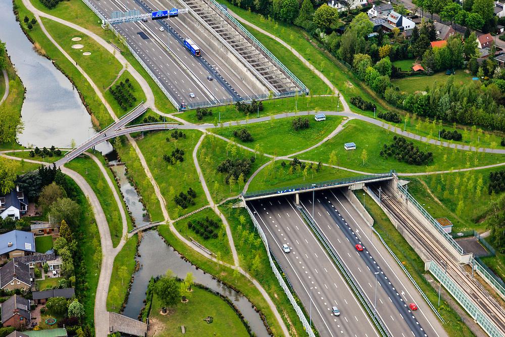 Nederland, Noord-Brabant, Breda, 09-05-2013; infrabundel, combinatie van autosnelweg A16 gebundeld met de spoorlijn van de HSL (re). Stadsduct Overbos in de voorgrond<br /> De bundel loopt in tunnelbakken, lokale wegen gaan over deze infrabundel heen, door middel van de zogenaamde stadsducten, gedeeltelijk ingericht als stadspark. <br /> Combination of motorway A16 and the HST railroad, crossed by  local roads by means of *urban ducts*, partly designed as public parks . <br /> luchtfoto (toeslag op standard tarieven);<br /> aerial photo (additional fee required);<br /> copyright foto/photo Siebe Swart.