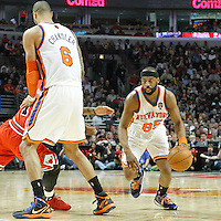 12 March 2012:  New York Knicks point guard Baron Davis (85) drives past Chicago Bulls point guard Derrick Rose (1) on a screen set by New York Knicks center Tyson Chandler (6) during the Chicago Bulls 104-99 victory over the New York Knicks at the United Center, Chicago, Illinois, USA.