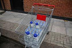 © Licensed to London News Pictures. 07/10/2020. London, UK. Cases of drinking water bottles in a shopping trolley as homes in East London are still without water following a water main pipe burst in Hackney Marshes on Tuesday. Photo credit: Dinendra Haria/LNP