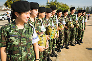 """11 JANUARY 2014 - BANGKOK, THAILAND: Thai army medics stand in a line during a Children's Day fair in Bangkok. The Royal Thai Army hosted a """"Children's Day"""" event at the 2nd Cavalry King's Guard Division base in Bangkok. Children had an opportunity to look at military weapons, climb around on tanks, artillery pieces and helicopters and look at battlefield medical facilities. The Children's Day fair comes amidst political strife and concerns of a possible coup in Thailand. Gen Prayuth has issued mixed signal on a coup at one point saying there wouldn't be one, and later saying he wouldn't talk about a possible coup. Earlier in the week, the Thai army announced that movements of armored vehicles through Bangkok were not in preparation of a coup, but were moving equipment into position for Children's Day.      PHOTO BY JACK KURTZ"""