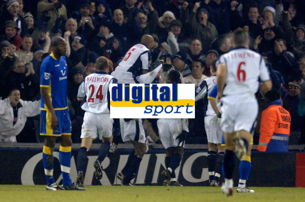 Photo: Glyn Thomas.<br />West Bromwich Albion v Tottenham Hotspur. The Barclays Premiership. 28/12/2005.<br />West Brom's players mob Nwankwo Kanu after he gives them a 1-0 lead.