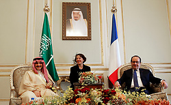 File photo - French President Francois Hollande (R) talks with Saudi business magnate and investor Prince Al-Walid ben Talal ben Abdelaziz Al Saoud during a meeting in Riyadh, Saudi Arabia on Tuesday, May 5, 2015. Hollande is the guest of honor of the 36th Gulf Cooperation Council Summit in Riyadh, where security issues in the region are going to be discussed. A new Saudi anti-corruption body has detained 11 princes, four sitting ministers and dozens of former ministers, media reports say. The detentions came hours after the new committee, headed by Crown Prince Mohammed bin Salman, was formed by royal decree. Among them is Prince Al-Walid ben Talal ben Abdelaziz Al Saoud. Photo by Christophe Ena/Pool/ABACAPRESS.COM