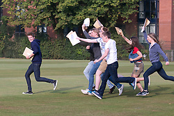 © Licensed to London News Pictures. 18/08/2016. Solihull School students receiving their A Level results earlier today. Pictured, Tom Carson does a Usain Bolt as he is chased by students after receiving their results. Photo credit: Dave Warren/LNP