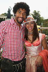 06.10.2013, Kaefers Wiesenschaenke, Muenchen, GER, der FC Bayern Muenchen beim Oktoberfest, im Bild Dante of Bayern Muenchen poses with Jocelina in front of the ensemble of the Bavaria statue, a monumental bronze sand-cast 19th-century statue and the Hall of Fame (Ruhmeshalle). The Bavaria is the female personification of the Bavarian homeland and by extension its strength and glory // during the Oktoberfest 2013 beer festival at Kaefers Wiesenschaenke in Munich, Germany on 2013/10/06. EXPA Pictures © 2013, PhotoCredit: EXPA/ Eibner/ Eckhard Eibner<br /> <br /> ***** ATTENTION - OUT OF GER *****