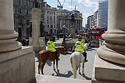 Mounted City Police officers make their presence known while on their horses in spring sunshine at Royal Exchange in the heart of the capital's financial district, on 19th April, in the City of London, England. (Photo by Richard Baker / In Pictures via Getty Images)