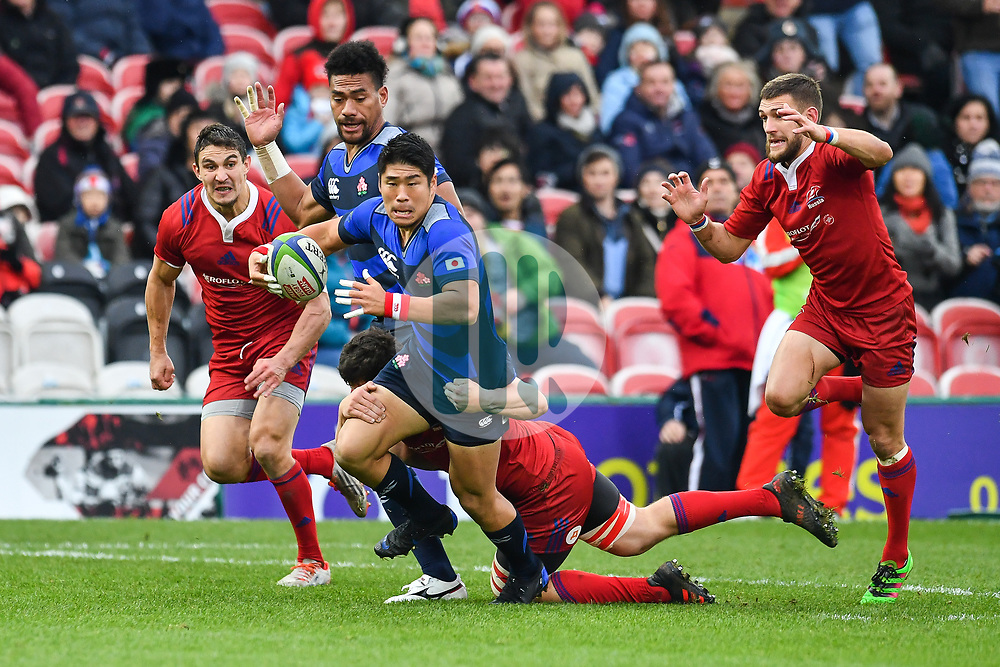 Rikiya Matsuda of Japan is tackled by Tagir Gadzhiev of Russia <br /> <br /> Photographer Craig Thomas<br /> <br /> Japan v Russia<br /> <br /> World Copyright ©  2018 Replay images. All rights reserved. 15 Foundry Road, Risca, Newport, NP11 6AL - Tel: +44 (0) 7557115724 - craig@replayimages.co.uk - www.replayimages.co.uk