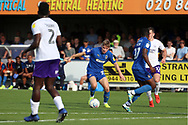 AFC Wimbledon midfielder Max Sanders (23) dribbling during the EFL Sky Bet League 1 match between AFC Wimbledon and Shrewsbury Town at the Cherry Red Records Stadium, Kingston, England on 14 September 2019.