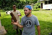 Ecuador, May 6 2010: Jorge holds a sweet potato. Copyright 2010 Peter Horrell