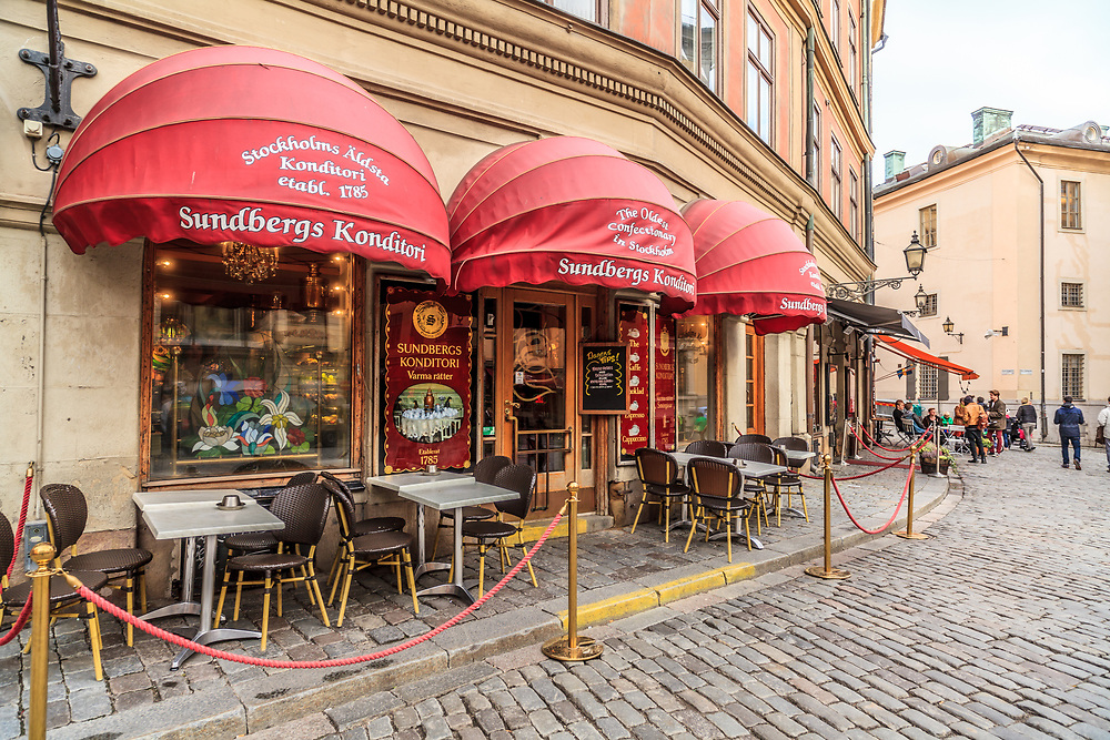 Sundbergs Konditori in Old Town in Stockholm, Sweden. Stockholm's oldest bakery-cafe that dates from 1785 with chandeliers, oil paintings and a copper samovar full of self-serve coffee creates a perfect coffee break.
