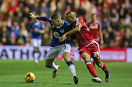 Everton midfielder Ross Barkley  takes on Middlesbrough midfielder Emilio Nsue  during the Capital One Cup match between Middlesbrough and Everton at the Riverside Stadium, Middlesbrough, England on 1 December 2015. Photo by Simon Davies.