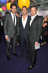 Left to right, DAVID GANDY, JENSON BUTTON and PAUL SCLUFOR at the 2009 Glamour Magazine Awards held in Berkeley Square, London on 2nd June 2009.