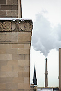 MILWAUKEE, WI – DECEMBER 16: A view of the Milwaukee County Safety Building, left, viewed against the steam from an industrial building on Friday, December 16, 2016.