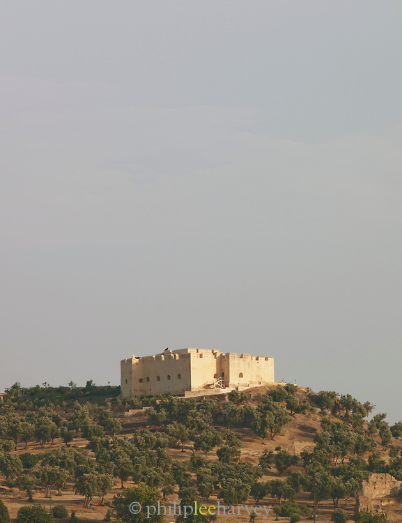 An old fortress that used to protect the city sits on top of a hill, overlooking the old city of Fes, Morocco