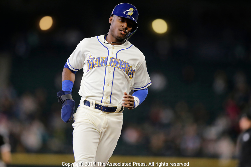 Seattle Mariners' Kyle Lewis advances to third on a single against the Chicago White Sox during the fourth inning of a baseball game, Sunday, Sept. 15, 2019, in Seattle. (AP Photo/John Froschauer)