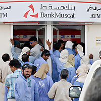 Hayma, Sultanate of Oman 31 March 2009.A group of Pakistani workers take money from a ATM..PHOTO: EZEQUIEL SCAGNETTI