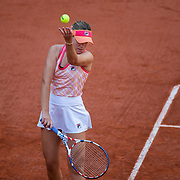 PARIS, FRANCE October 07.  Sofia Kenin of the United States performs her no look ball toss while serving against Danielle Collins of the United States in the Quarter Finals of the singles competition on Court Philippe-Chatrier during the French Open Tennis Tournament at Roland Garros on October 7th 2020 in Paris, France. (Photo by Tim Clayton/Corbis via Getty Images)