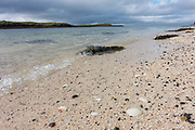 Coral Beach In Claigan on the 5th September 2016 on the Isle Of Skye In Scotland in the United Kingdom. Coral beach is made from crushed white coral like seaweed that makes the water look tropical blue when the sun comes out.