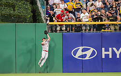 Jun 15, 2018; Pittsburgh, PA, USA; Cincinnati Reds right fielder Scott Schebler (43) catches a fly ball at the fence from Pittsburgh Pirates right fielder Gregory Polanco (25) during the fifth inning at PNC Park. Mandatory Credit: Ben Queen-USA TODAY Sports