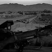 Jul 25, 2008 - Zhari District, Kandahar Province, Afghanistan - An Afghan civilian walks his sheep past a Canadian machine gun position somewhere on the district line between Zhari and Panjwai Districts, Kandahar Province, Afghanistan..(Credit Image: © Louie Palu/ZUMA Press)