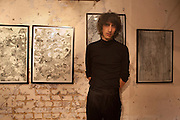 FARIS BADWAN, Faris Badwan: ( Lead singer of The Horrors also an artist/ illustrator) Drawing A Straight Number Nine - private view. The Book Club, 100-106 Leonard Street, London EC2, 11 August 2010. <br /> <br /> -DO NOT ARCHIVE-© Copyright Photograph by Dafydd Jones. 248 Clapham Rd. London SW9 0PZ. Tel 0207 820 0771. www.dafjones.com.