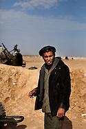 A sel professed follower of Osama Bin Ladin mans an anti aircraft outside of  Adjabiya on March 3, 2011.