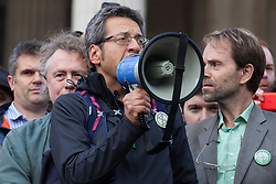 London, UK. 16 October, 2019. George Monbiot, Guardian journalist, author and environmental campaigner, addresses hundreds of climate activists from Extinction Rebellion defying the Metropolitan Police prohibition on Extinction Rebellion Autumn Uprising protests throughout London under Section 14 of the Public Order Act 1986 by attending a Right to Protest assembly in Trafalgar Square. He was later arrested by the Metropolitan Police after sitting in the road in Whitehall.