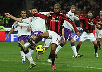 Il giocatore del Milan ROBINHO contrastato dal giocatore della Fiorentina MANUEL PASQUAL.<br /> 20/11/2010, Milano, Milan Fiorentina 1-0<br /> ALBERTO CAMICI / INSIDEFOTO