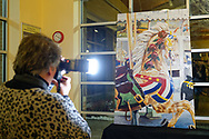 Garden City, New York, USA. March 9, 2019. MAUREEN LENNON captures photos during Unveiling Ceremony event of mural by painter Michael White, held at historic Nunley's Carousel in its Pavilion on Museum Row on Long Island.