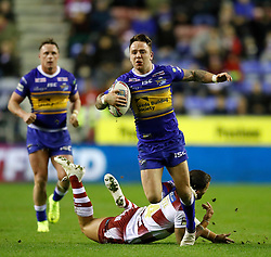 Leeds Rhinos Richie Myler skips away from a tackle by Wigan Warriors Romain Navarrete during the Betfred Super League match at the DW Stadium, Wigan.