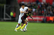 Ki Sung-Yueng of Swansea city (l) challenges Raheem Sterling of Manchester city. Premier league match, Swansea city v Manchester city at the Liberty Stadium in Swansea, South Wales on Saturday 24th September 2016.<br /> pic by Andrew Orchard, Andrew Orchard sports photography.