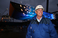 Royal Caribbean International 'Project Genesis' keel laying ceremony in Turku, Finland....The worlds largest cruise ship, currently known as Project Genesis ,  has it's first segment layed in dry Dock in Turku Finland today. The ship is due to be compleated in autumn 2009 and will be 40% bigger than the current world largest cruise ship also owned by Royal Caribbean International...Captain William Wright, Senior Vice President, Marine Operations, infront of the first segment of Project Genesis to be laid in the dry dock in Turku, Finland.
