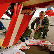 Engineering ground staff of the Red Arrows, Britain's RAF aerobatic team, make repairs between training flights.
